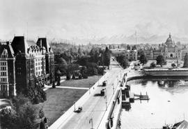 Looking south on Government Street in Victoria, showing the Empress Hotel, the causeway and the l...