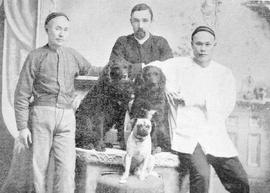 What appears to be the family servants and dogs - otherwise unidentified.