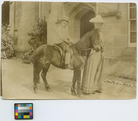 [Lindley family friends : woman and child on pony]