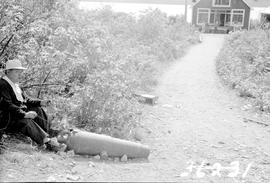 Kitimat; Mr. Ed Wesley and his cannon, which was brought from Bella Coola in the 1850's.