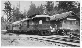 Gas-electric car no. 104, 3/4 right, semi-closeup, good detail, hauling freight car at Whytecliff...
