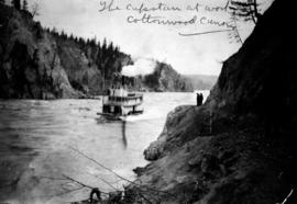 """The Capstan at work, Cottonwood Canyon""; sternwheeler Charlotte navigating Cottonwood Canyon, Fraser River."