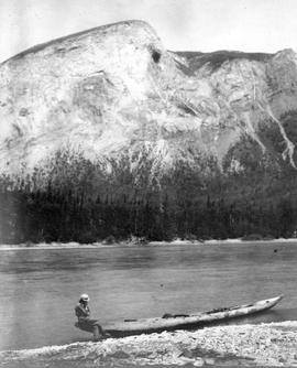 A man in a canoe on the bank.