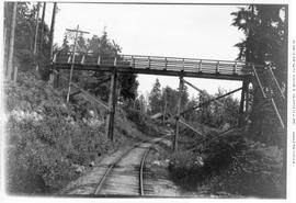 right-of-way west of Altamont, BC, single track with wooden highway overpass bridge, June 18, 1923