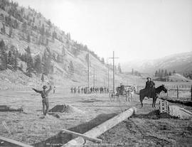 Raising poles on line, West Kootenay Power and Light Co. Ltd., near Grand Forks