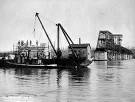 """Completing masonry pier No. 3""; construction of the Fraser River Bridge in New Westmin..."