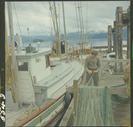 Fisherman mending net Queen Charlotte City, Queen Charlotte Islands