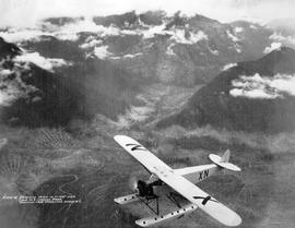 """A2836-33, Fairchild FC2W in flight over Camp No. 8, logging area, Nimkish Lake, Vancouver I..."