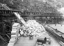 Ocean Falls pulp and paper mill; wood block flume from sawmill, showing conveyor under construction