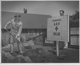 Brigadier D. R. Sargent, Officer commanding Nanaimo defences, planting headquarters poster at civ...