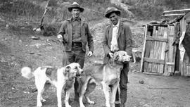 George Ball and Mike with sled dogs.