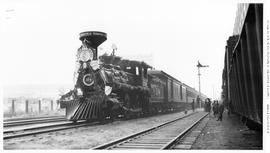 "4-4-0 No. 374, American. 3/4 Right. On The  Head Of A 4-Car Train On A One-Mile ""Run"" F..."