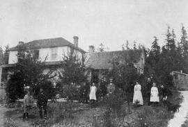 The Reverend Robert James Roberts family outside their residence.