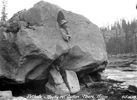 """Pothole - Rocky Mountain Canyon - Peace River""; George Copley standing in rock formation."