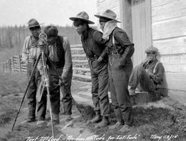 """Fort McLeod, meridian altitude for latitude, May 23/14""; group of aboriginal men exami..."