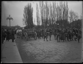 Troops and civilians intermingle on the streets of Victoria