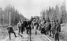 Canadian Pacific Railway workers, excluded from the official ceremony, drive their own last spike near on the Canadian Pacific Railway, near Donald