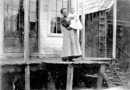 Allie Bowron and baby Aileen Bowron in front of Mrs. J. Watson's home; Barkerville.