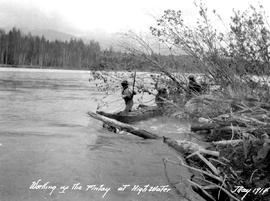 Survey crew tacking up the Finlay River during a flood.