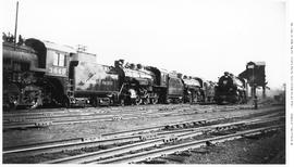 Engine Terminal Scene. Possibly Fort William, Ontario, 5 Locomotives Out Of Service.  L To R: Con...