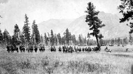 """D Troop, N.W.M.P. and pack train crossing the Rockies."""