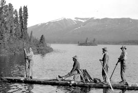 Surveyors Mackenzie, Davidson, Thorne Forrest and Al Phipps rafting on Kitchener Lake.
