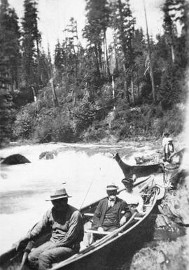 James Dunsmuir, in the centre of the first canoe; Dunsmuir photograph