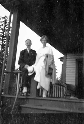 Unidentified couple on the porch.