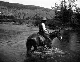 Moose Dixon fording the Bonaparte.