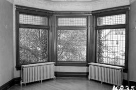 The stained glass bay window in the main reception room, second floor; George H. Aylard's re...