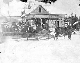 Group in a large sleigh outside Fred Brand's new house in Alberni.