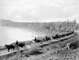 A carriage drive in February in Victoria B.C., the most westerly city in Canada.  About 1907 - Provincial Mining Convention - 45 carriages in line [along McNeill Bay].  A.S. Cameron, 6325 Monroe Ave.