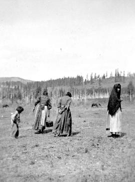 Beaver Indians; a child and three women, at Hudson's Hope.