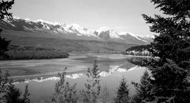 Approximately 10 kilometres south of Golden; looking from the east bank of the Columbia River to the Dogtooth Range of the Purcell Mountains.