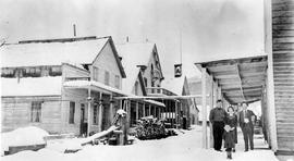 Main Street, Barkerville.  Kelly's Hotel And Group Of  People Shown.