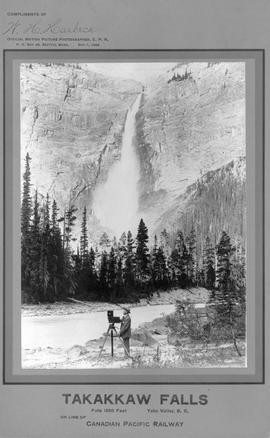 """Compliments of W.H. Harbeck, Official Motion Picture Photographer, C.P.R.""; American cinematographer Harbeck and his camera in front of Takakkaw Falls, Yoho Valley, on line of Canadian Pacific Railway"