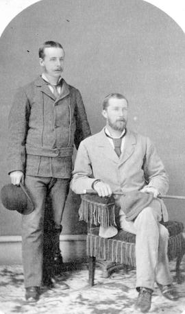 Andrew McKenzie, seated; with George Wake.