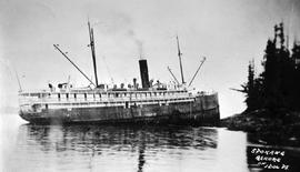 """Spokane ashore""; the SS Spokane aground at Idol Point, Dufferin Island."
