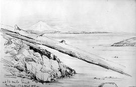 At 10 Mile Point  [showing log and rocks in foreground, Mount Baker in background].