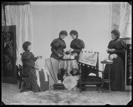 Tableau vivant featuring multiple (four) Hannah Maynards in a studio attributed to Mrs. R. Maynar...