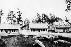 Three frame structures built during the Crimean War at Esquimalt; built by Governor Douglas in an...
