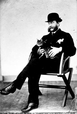 Governor Frederick Seymour and pet cat; see also B-07224; this is original photo of the two.