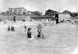 Seraphim Fortes, later known as Joe, teaching a child to swim in English Bay, Vancouver.