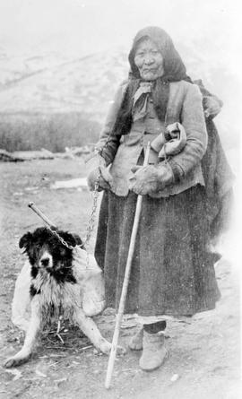 Unidentified First Nations woman and her dog.