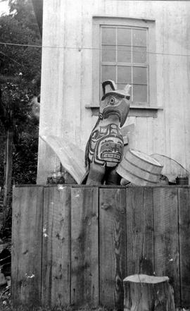 A small totem outside a home; miscellaneous E album.