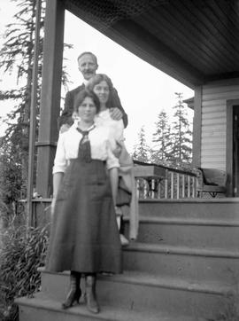 Unidentified family on the porch of their home.