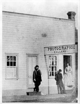 Hannah Hatherley Maynard's photographic studio in Victoria.  Hannah is standing in the doorway.