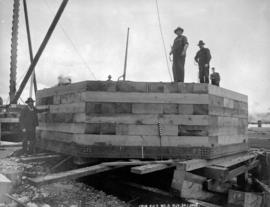 """Crib pier No. 5""; construction of the Fraser River Bridge in New Westminster."