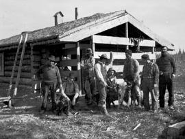 Group at Ross' cabin, near Fort Grahame on the Finlay River.