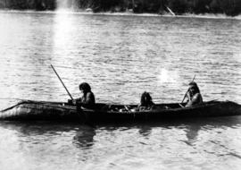 First Nations group in a canoe.